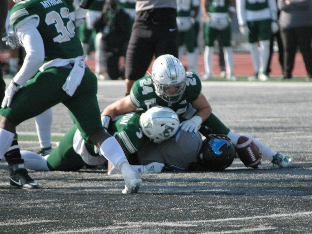 EMU defensive backs Vince Calhoun and Brody Hoying force an incomplete pass at Rynearson Stadium on Nov. 2.
