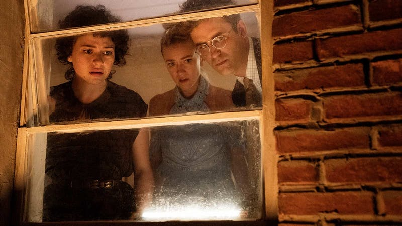 The characters of Search Party peer out of a window. Retrieved from IMDb.
