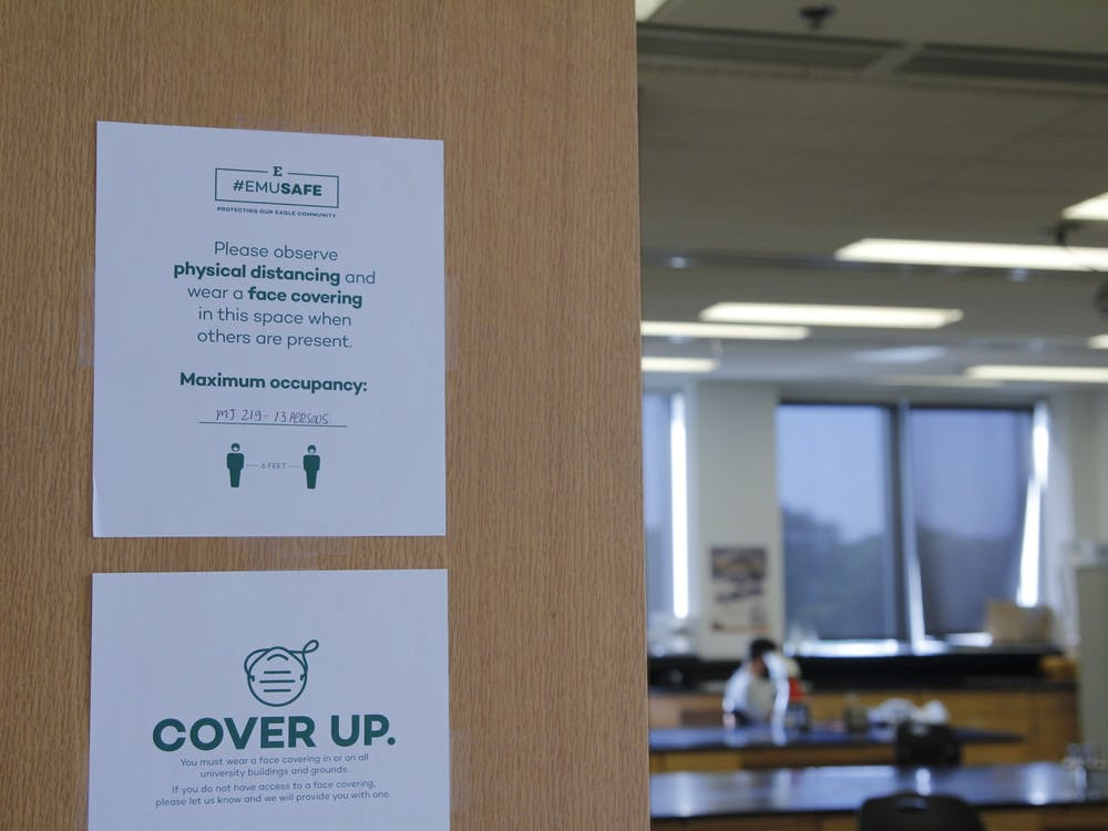 Classroom maximum capacity is listed on the classroom's entrance. COVID-19 signage has played a crucial part in the reopening of Eastern Michigan University's campus for fall courses.