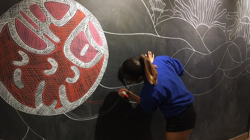 Sidney Phan draws on Sweetwater's chalk walls. She displays her artwork on her Instagram: @phan.sidney