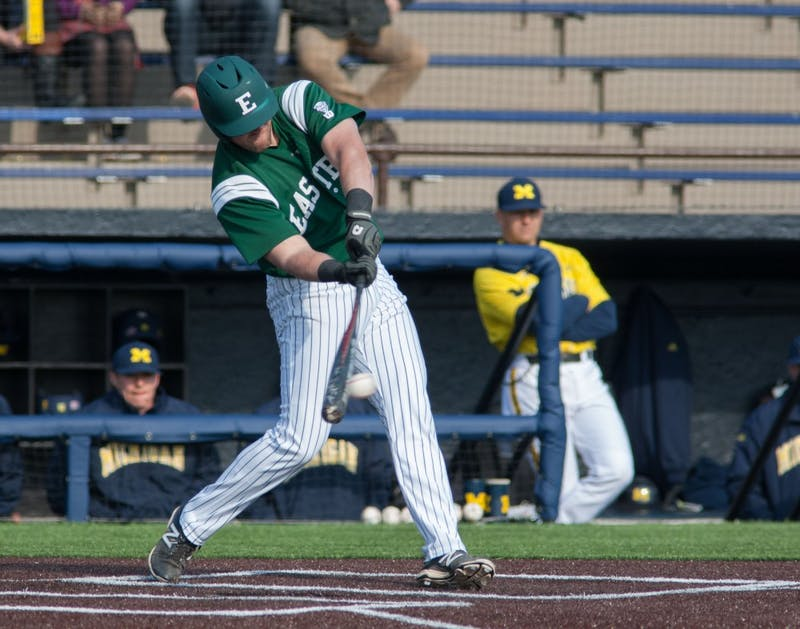 Eastern Michigan first baseman Lee Longo delivers one of his two hits in the Eagles 4-3 10th inning win over Michigan Wednesday afternoon in Ann Arbor.
