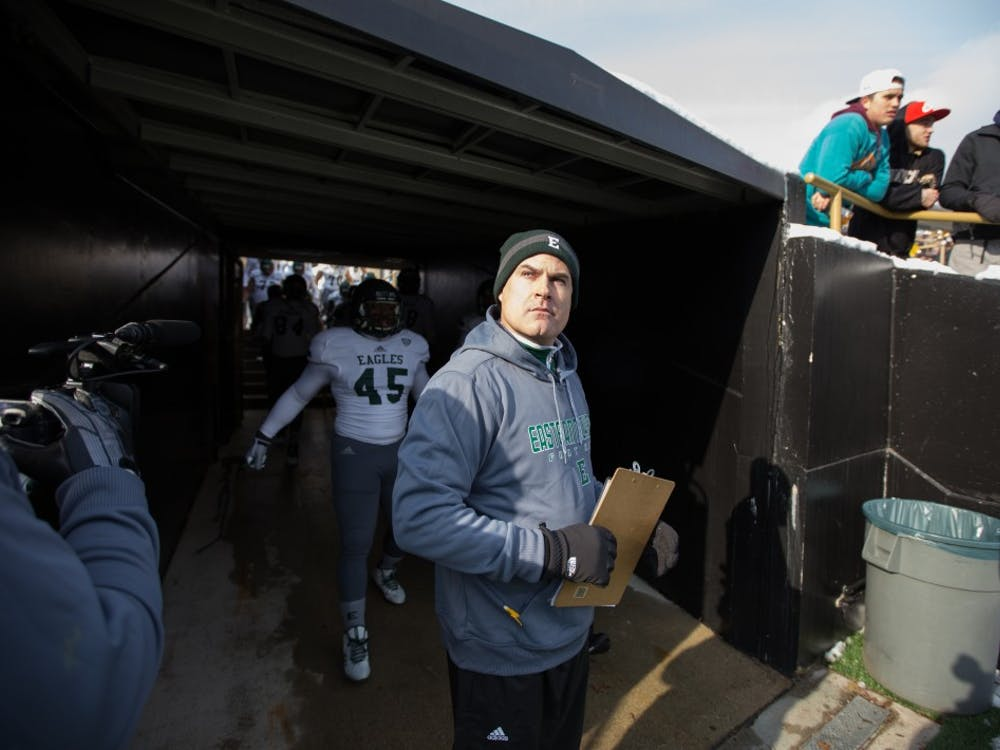 Eastern Michigan coach Chris Creighton prepares to lead his team onto the field in the Eagles 51-7 loss to Western Michigan Saturday afternoon in Kalamazoo.