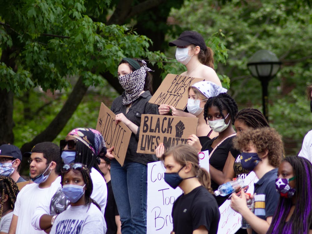 People gathered at the University of Michigan diag on Saturday, May 30 after marching through Ann Arbor.