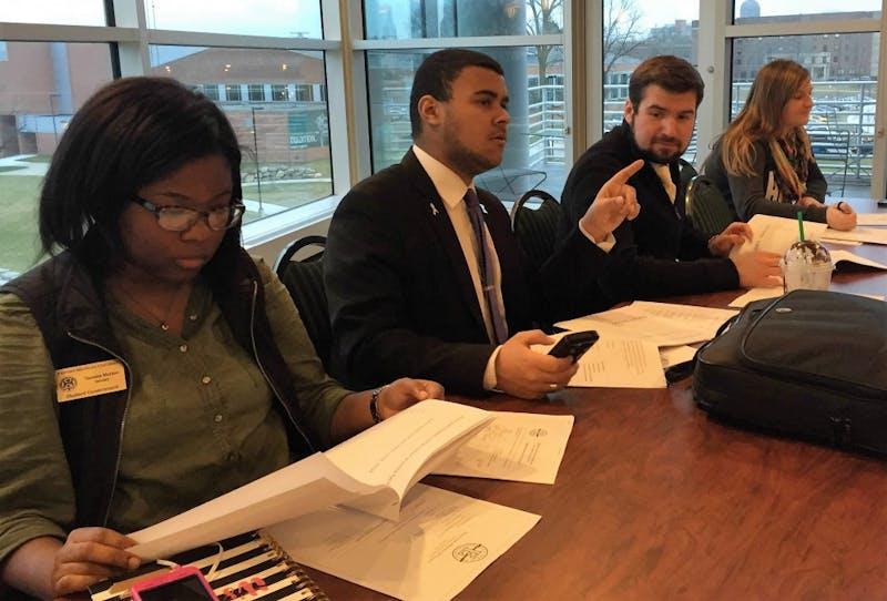 From left to right,Senator Tanisa Morton, Senator Sam Jones-Darling, Judicial Sergeant John McAllister, and Speaker of the Senate Kiera Fegan at March 15 Student Government Meetings.