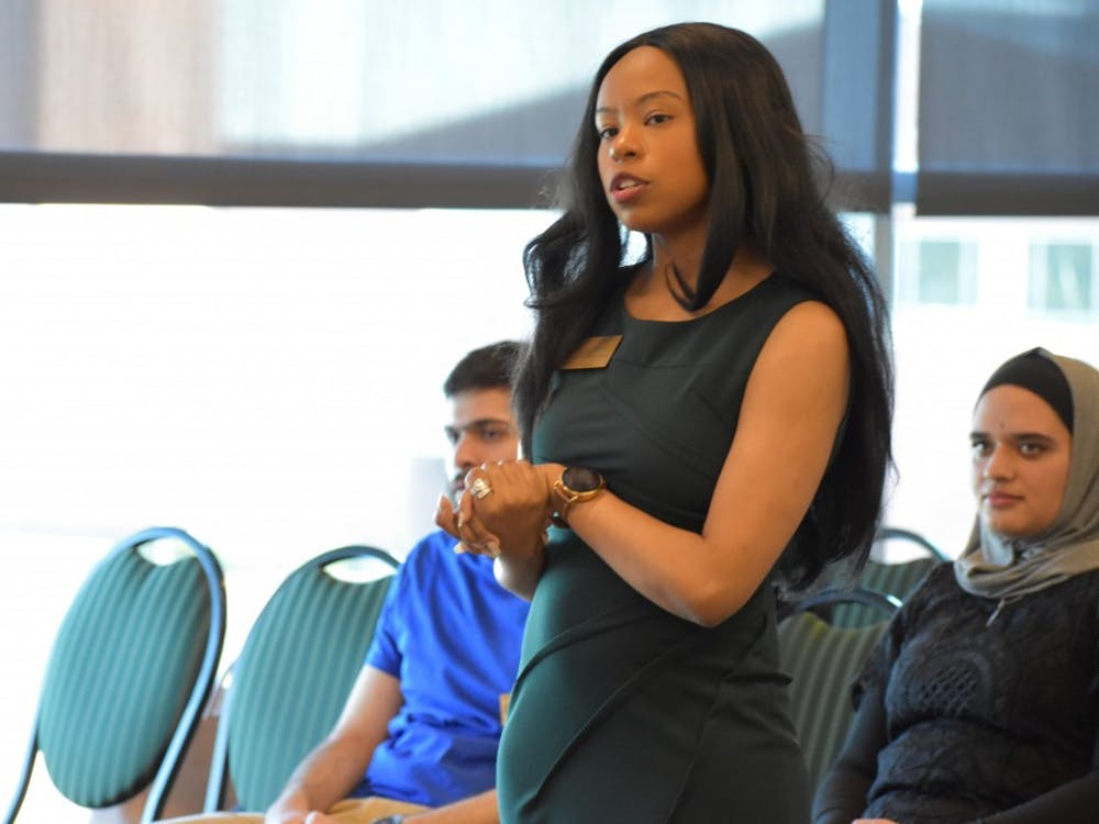 Student Body President Candice Crutcher talking with the Student Senate at the last meeting of the 105th Senate on Tuesday, April 9 at the Student Center.