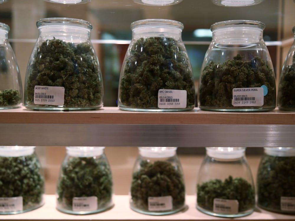 Jars containing various strands of medical marijuana sit behind a display case at the River Rock Medical Marijuana Center in Denver, Colorado, on May 16, 2013. (Anthony Souffle/Chicago Tribune/MCT)