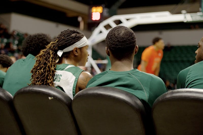 Damari Parris watches from the bench at the Convocation Center on Jan. 22.