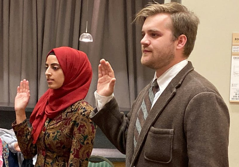 Duaa Aljirafi (l to r) and Domenic Dame are sworn into the Senate on Tuesday, Oct. 22.