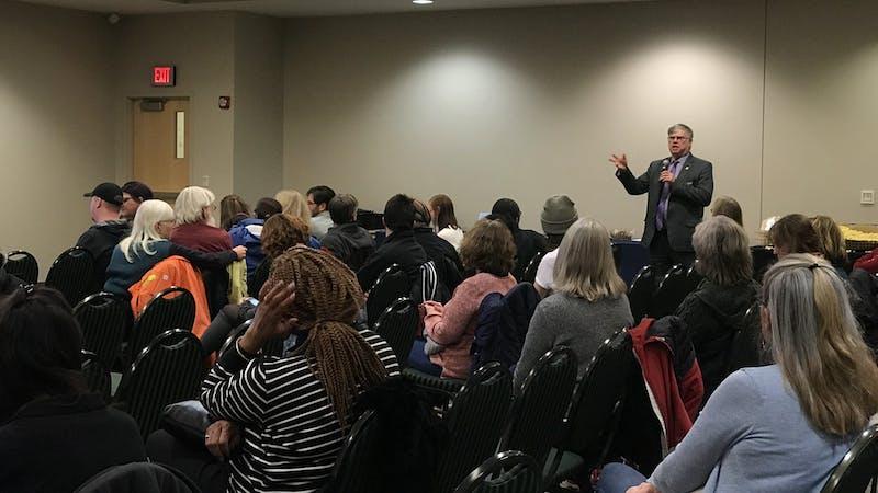 Dr. David Winters addresses crowd at film screening of Intelligent Lives.