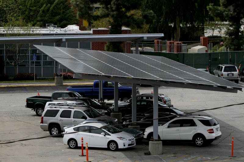 Solar panels are being installed in the parking lot of Taft High School in Woodland Hills, California, on March 27, 2012. California schools are turning to solar in hopes of saving billions state-wide on energy. (Anne Cusack/Los Angeles Times/MCT)