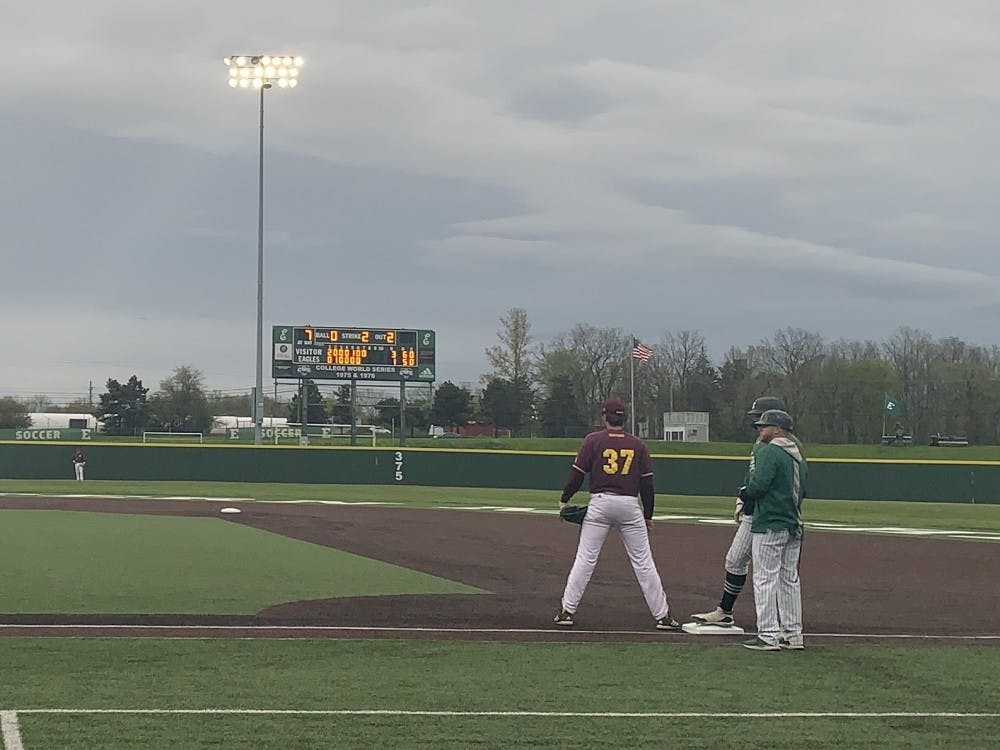 Evan Kratt and Jeff Timko stand at first base on May 11 at Oestrike Stadium.