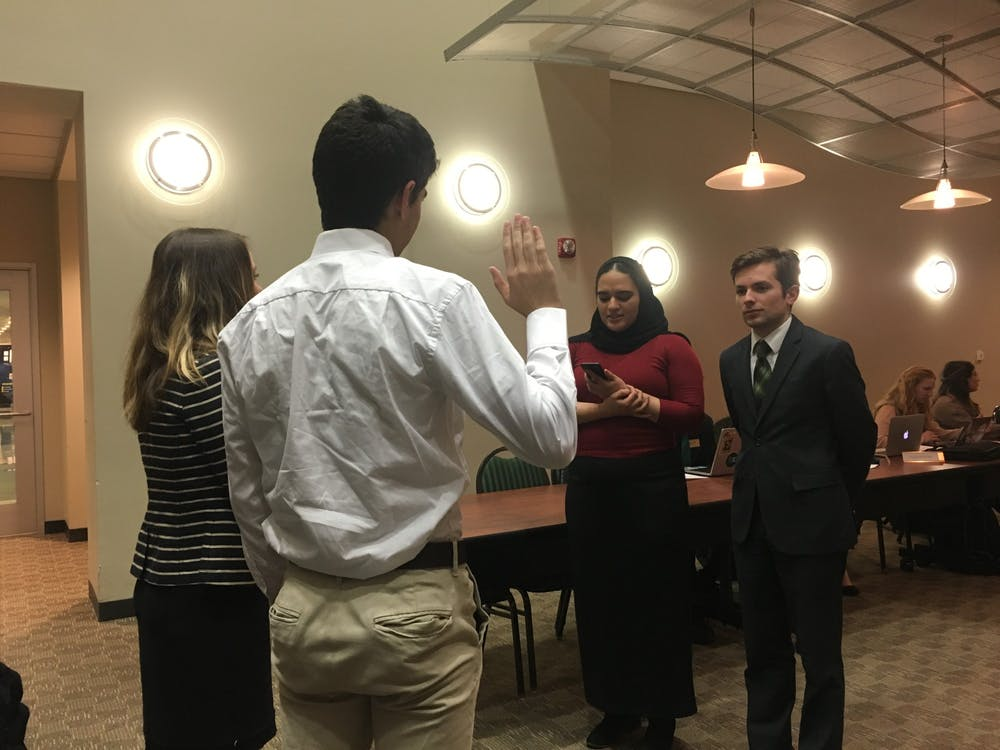 Auryon Azar and Erin McCargar are sworn into the Senate.