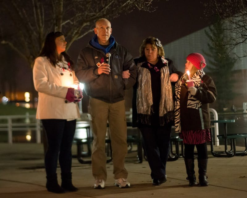 Jim Turnquist speaks at candlelight vigil for daughter Julia.
