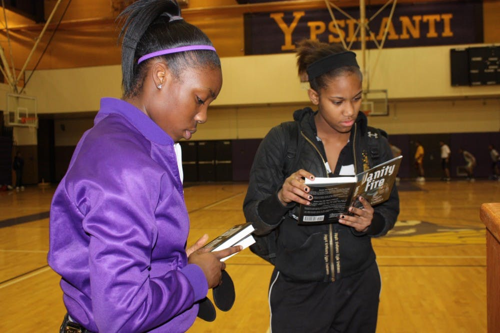 Ypsilanti High students score free books courtesy of the NFL
