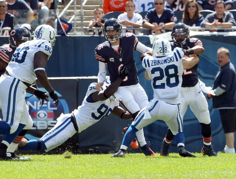Chicago Bears quarterback Jay Cutler (6) gets sacked by Indianapolis Colts defensive end Robert Mathis (98) during the first quarter of their game at Soldier Field in Chicago, Illinois on Sunday, September 9, 2012. The Bears defeated the Colts, 41-21. (Nuccio DiNuzzo/Chicago Tribune/MCT)