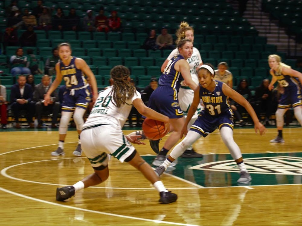 Corrione Cardwell controlling the ball up court against Kent State on Feb. 13.