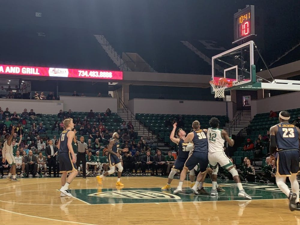 Paul Jackson (left) shoots a 3-pointer against Toledo on Feb. 19 at the Convocation Center.