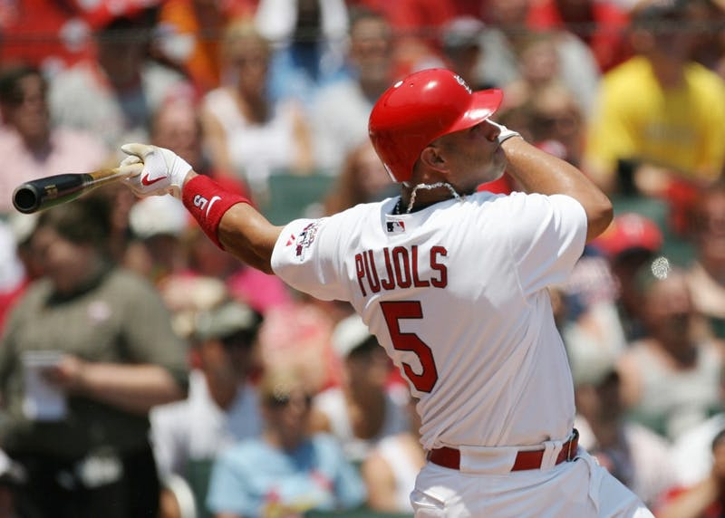 MVP-winning Cardinal Albert Pujols hits a two-run home run in the against the Minnesota Twins at Busch Stadium in St. Louis, Missouri. Pujols adds 30 some home runs each year to his team.Rya