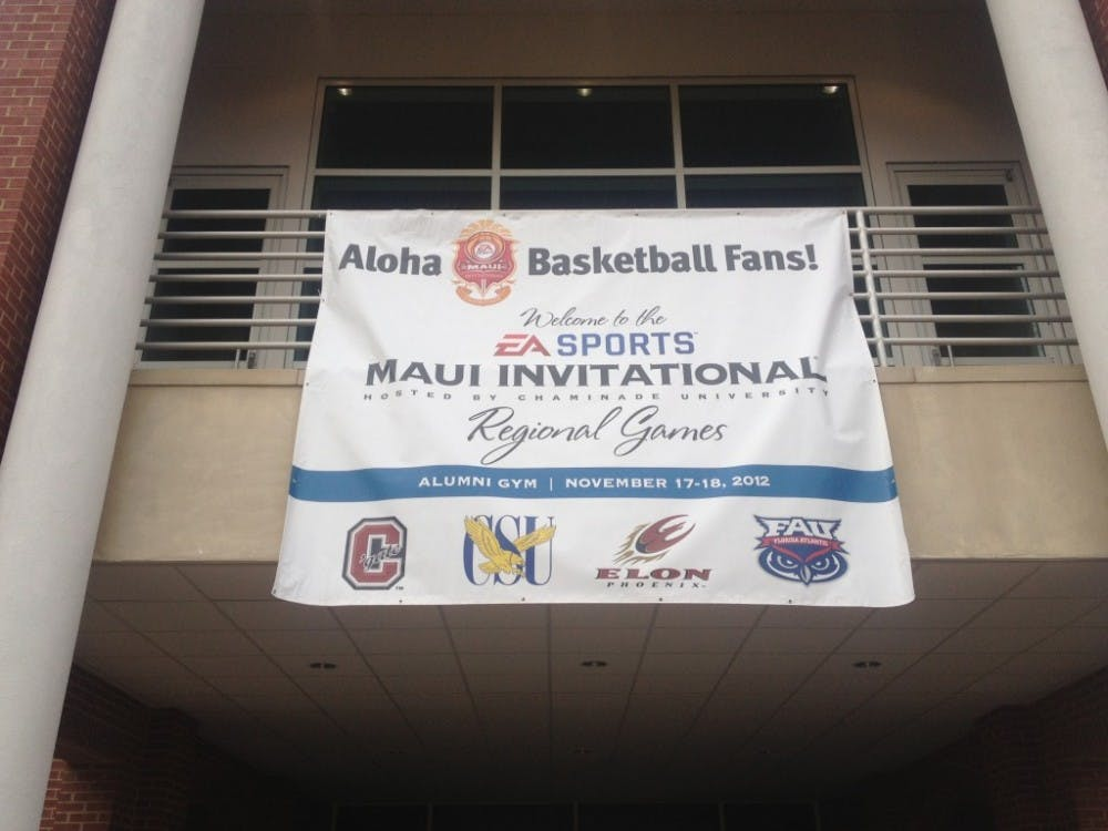 This banner hangs at the front door of the Koury Center, advertising the home of the EA Sports Maui Invitational Regional Games. Photo by Zachary Horner, ...