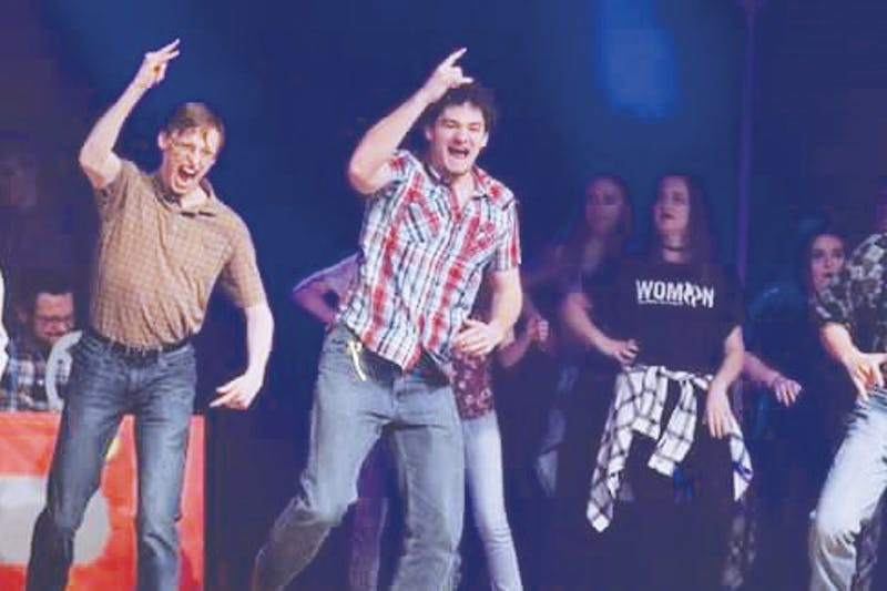 Daniel McHenney (left) dances in Second West Olson's Airband performance in 2018.