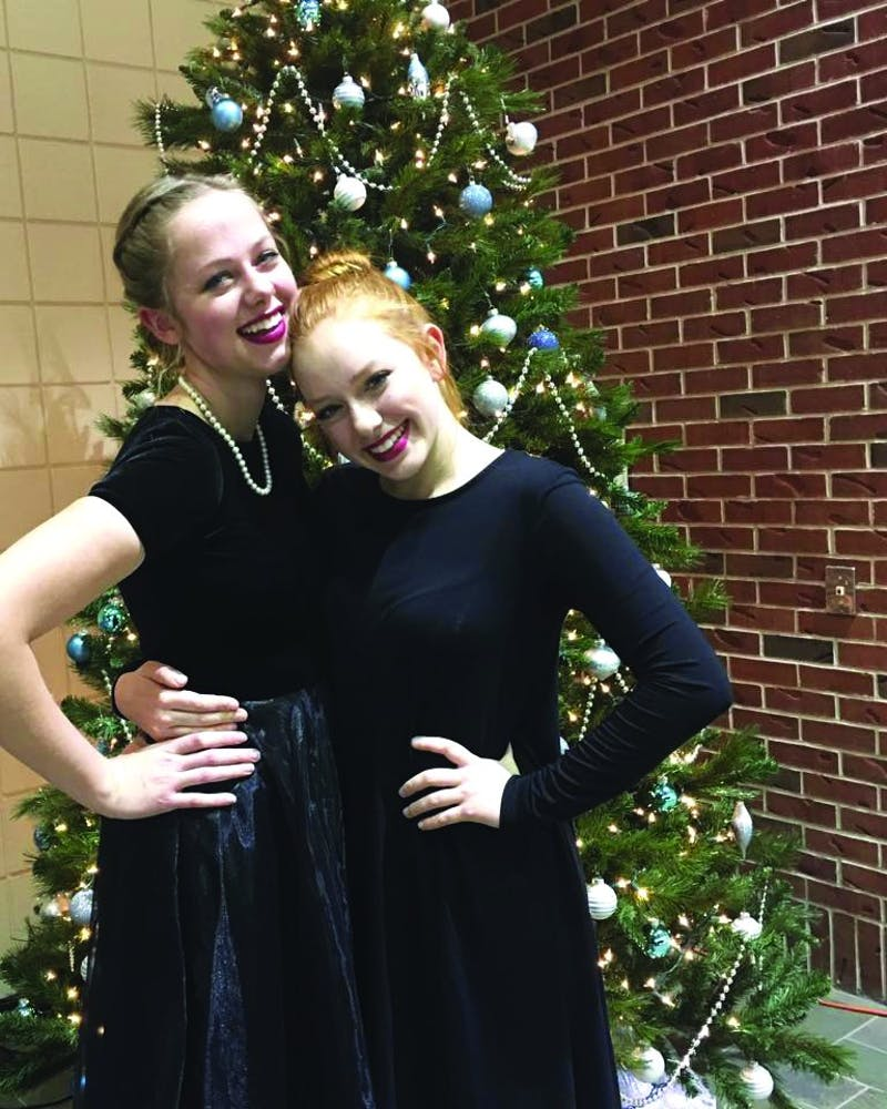Chorale members Elizabeth Carrier and Madeline Logan pose in Rupp recently. (Photograph provided by Elizabeth Carrier)