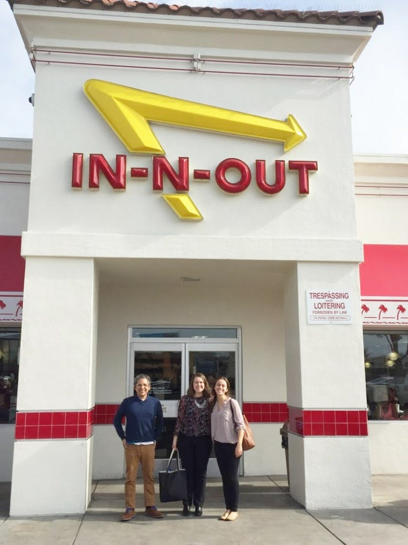 (L to R) Dr. Eric Hernandez, junior Anna Cummings and graduate student Danielle Spoutz enjoy fast food at a recent trip to California promoting the Enactus program. (Photograph provided by Anna Cummings)