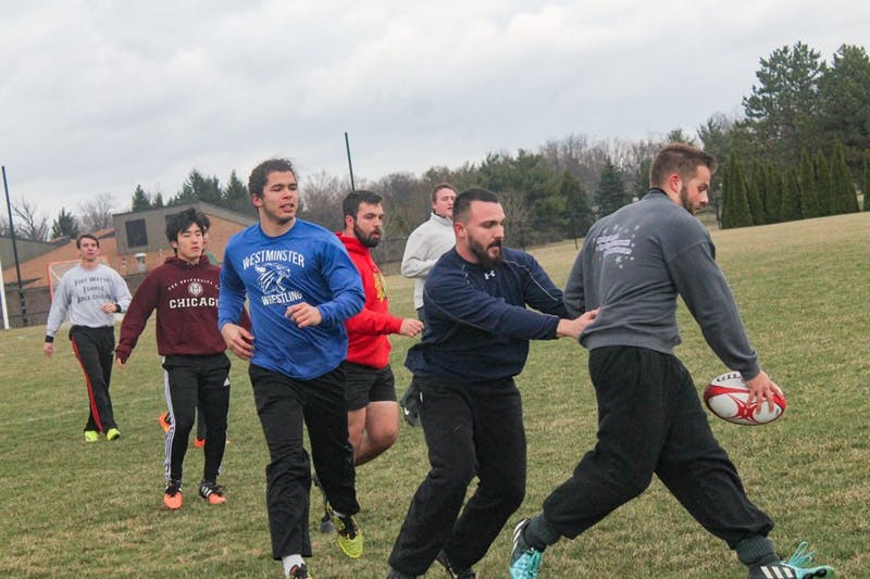 Photograph by Halie Owens. Rugby players (R to L) Aaron Hussey, Eric Castigila, Samuel Thomas, Caleb Mackintosh, Juyeong Jeong, Michael Snyder practice despite not being sponsored by Taylor.