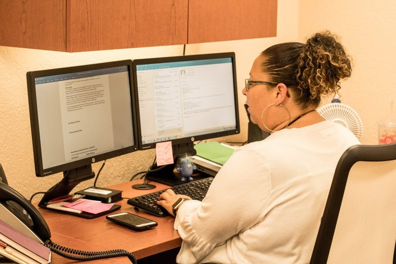 Assistant Director of Human Resources April Evans works to prevent email phishing.