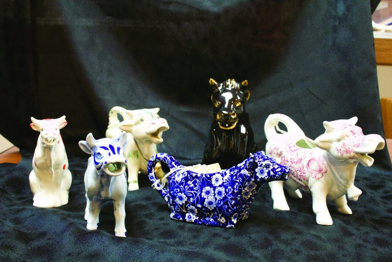 The cow creamer collection has a wide variety, including pieces spanning three centuries and three continents. (Photograph by Kassie Joviak)