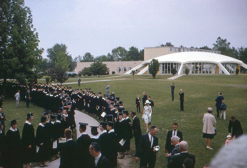 Students line up next to our beloved Union decades ago for graduation.