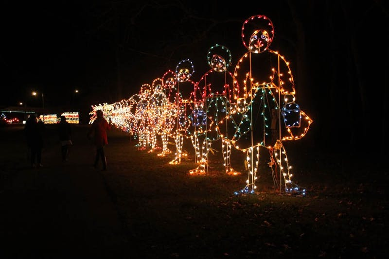 "(Photograph by Ruth Orellana) Eight maids a milking in the ""Twelve Days of Christmas"" light display"