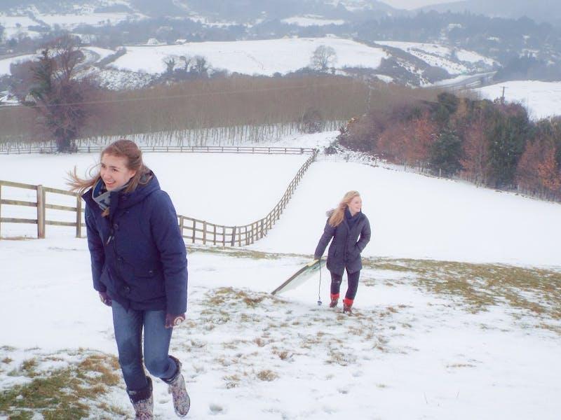 Juniors Sarah Brennan and Meghann Rauser sled in a rare Irish snowstorm.