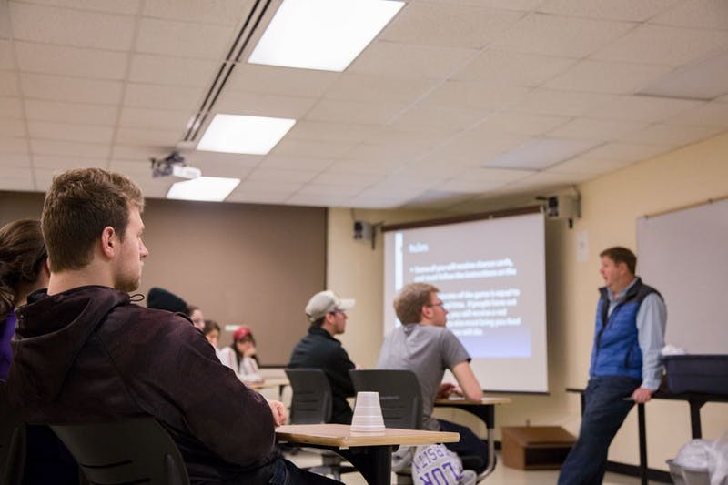 Senior Blake Wheeler intently listens to professor Michael Jessup in the debriefing session after the two-hour refugee simulation hosted by the Sociology department and Global Outreach. (Photo by Hannah Bolds)