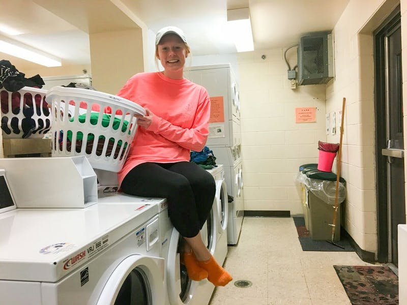 Junior Lilly Burton is excited about Olson Hall's new washers and dryers (photo provided by Natalie Rupp).