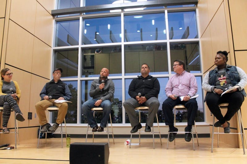 Jim Spiegel, Gary Ross, Kyle Gould, Bob Aronson and Bria Howard made up a panel to discuss #takeaknee on Tuesday night. (Photograph by Halie Owens)