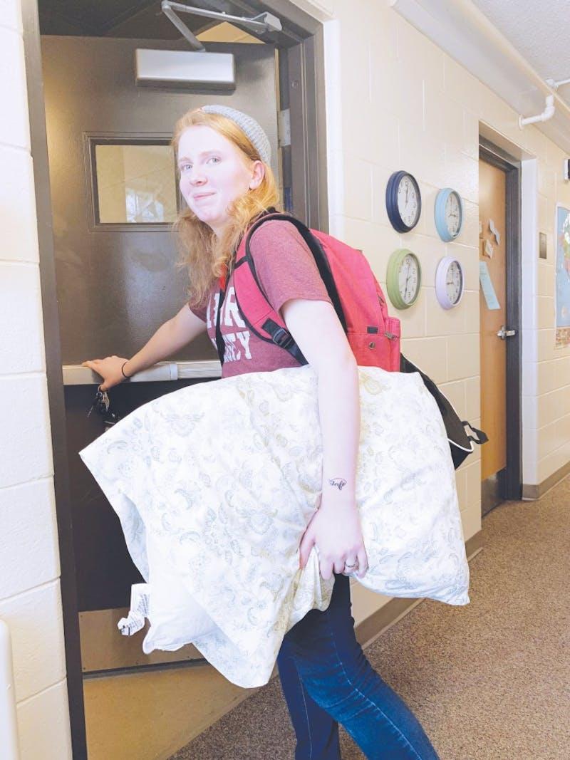 Junior Erin Hetrick heads out the door for her break.