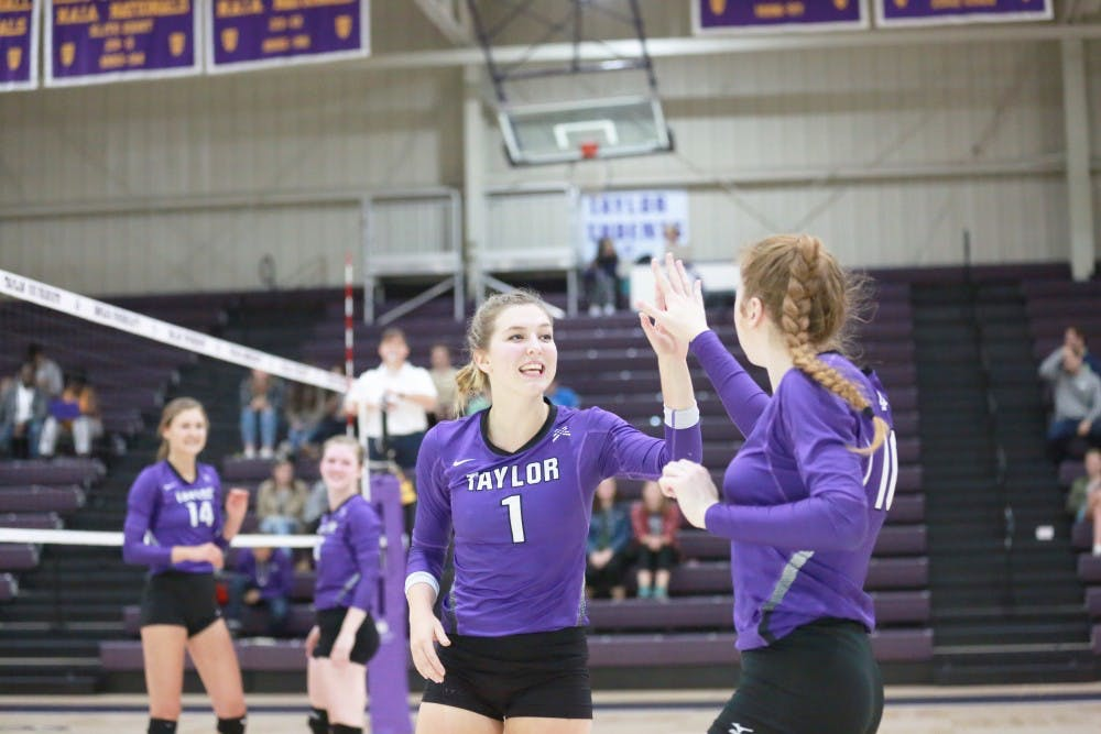 Trojans smash Cougars in three sets