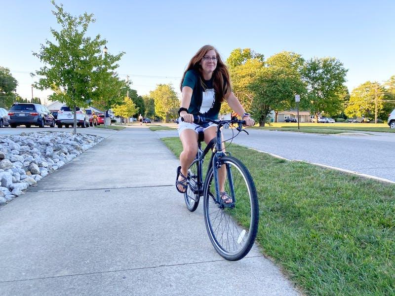 Senior Josie Koontz rides by the Student Center on her bike