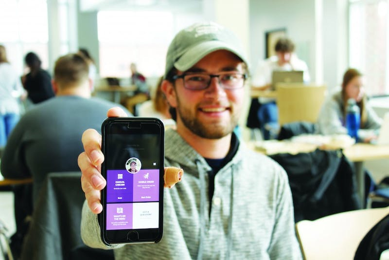 Sophomore Jimmy Schantz proudly poses with the new Creative Dining app, Eatable. (Photograph by Riley Hochstetler)