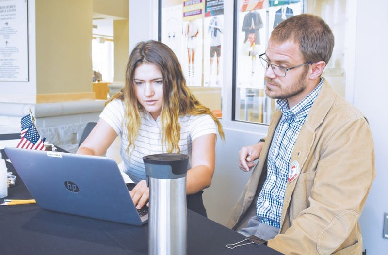 "Sophomore Leah Conley gets assistance registering to vote from Dr. Jakob Miller. ""Registering to vote is quick and easy, and it can be done on paper or online,"" says Miller."