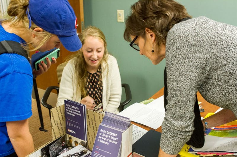 Junior Kristina Hoon, receives guidance from Dr. Tyner, professor of education and department chair, about the JuMP program. (Photo by Naomi Page)
