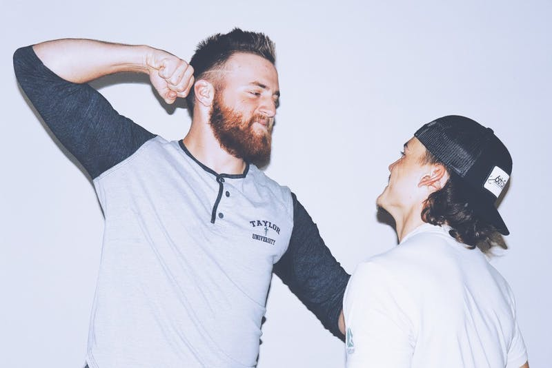 Sophomore Noah Huseman and Junior Brett Lawson participate in a heated rivalry.