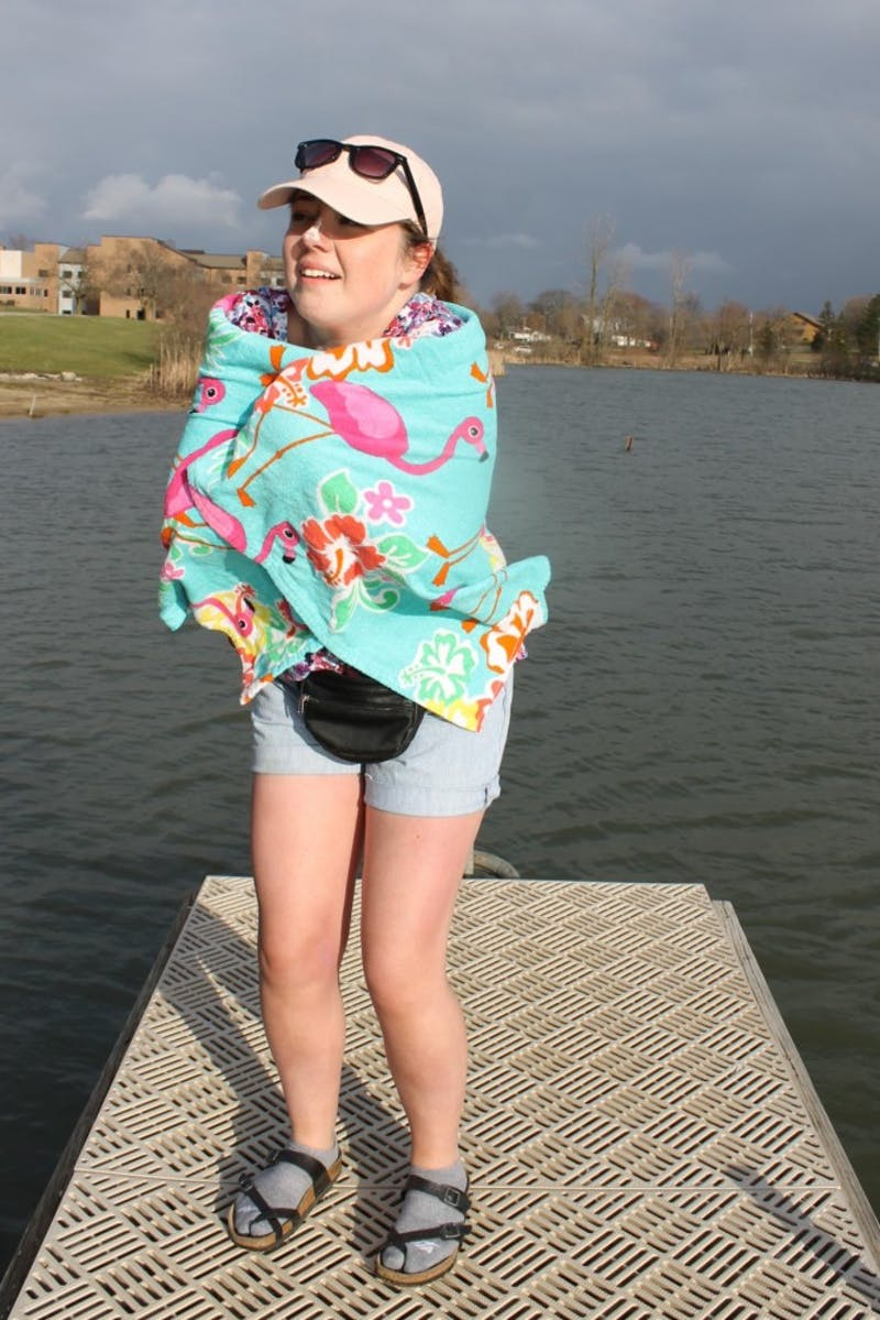 Janel Reichert poses as a student trapped in chilly Indiana for spring break.