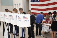 People voting in polling place --- Image by © Hill Street Studios/Blend Images/Corbis