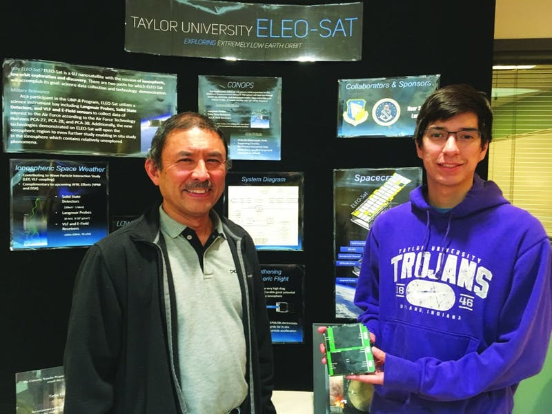 (L to R) Professor of Computer Science and Engineering Bill Bauson stands with senior Justin Theien, who is the chief engineer for the new ThinSat satellite project. (Photograph by Hannah Stumpf)