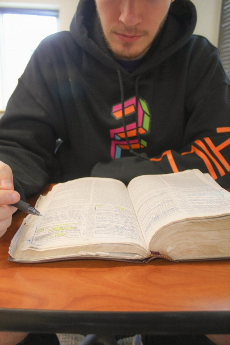 A student opens his Bible for study