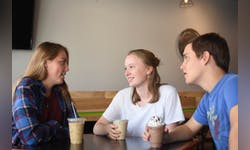 Sophomores Gillian Haenggi and Ruthie Claydon and freshman Jon Yoder enjoy coffee and community at The Branch.