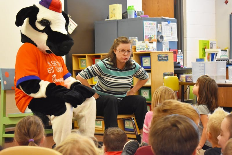 Kindergarteners at Eastbrook South Elementary listen attentively as a special guest joins their class. (Photograph provided by Andrea Shively)