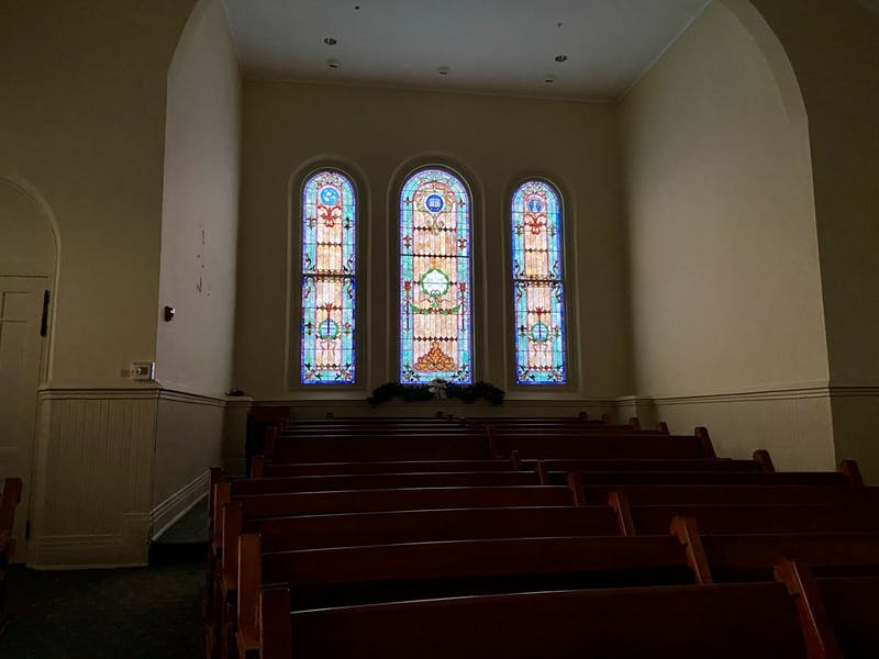Church pews offer a place of reflection.