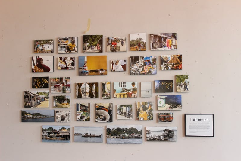 Senior Jaime Wills displays her photo collection from her past J-Term trip at The Bridge. (Photography by Anna Collins)